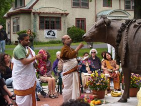 T.R. Sampathkumar of Epping, N.H., and T.L. Krishnabhatta of Ashland, left, bless the statue of Emily the Cow Sunday at the Sherborn Peace Abbey.